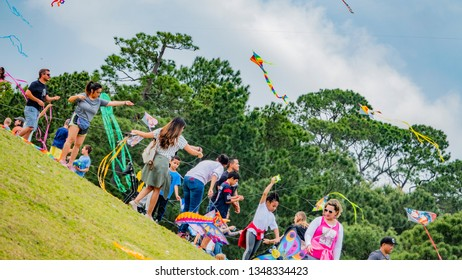Houston, Texas, USA March 24th,2019. Sixth annual Hermann Park Conservancy Kite Festival in Houston Texas. People flying kites at Hermann park and Miller Theatre