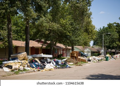 Houston, Texas, USA, September 10 2017: Damaged houses on one of the streets. After hurricane Harvey. Trash and damaged households outside the houses.