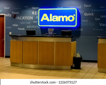 Houston, Texas, USA - September 22, 2018: Sign of Alamo Rent a Car at Airport Counter ,  an American rental car agency owned by Enterprise Holdings.