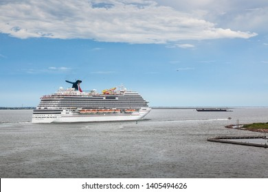 HOUSTON, TEXAS, USA - September 9, 2018: The Carnival Breeze cruise ship is leaving the Port of Houston for a 7-day excursion.  Space for copy overlay.