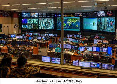 Houston, Texas / USA - September 9, 2019: People watching the flight control teams in the mission control room at NASA, who monitor the astronauts at the International Space Station ISS