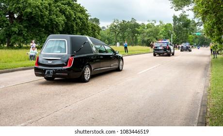 Houston, TX - April 21, 2018: Former First Lady Barbara Bush motorcade passes through Memorial Park Houston Texas.