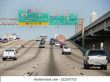 HOUSTON, TX - MAR 1, 2009: Traffic flows on the interstate to Houston, TX. Traffic congestions are a often a problem for many people going in and out.