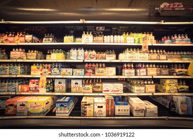HOUSTON, TX, US - JUL 3, 2017:Wide selection of domestic and imported beer at grocery store open fridge. Various bottles of craft, microbrews, IPA, from around the world on shelf display. Vintage tone