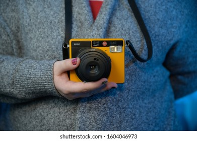 Houston, TX / USA - December 31st, 2019: Woman Holding Instant Leica Sofort Camera during Christmas Party
