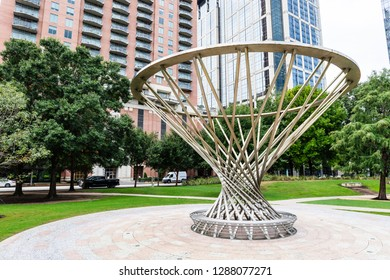 HOUSTON, TX, USA - SEPTEMBER 12, 2018: The Mist Tree is located on the Sarofim Picnic Lawn in Discovery Green Park. This structure was created by Doug Hollis, a San Francisco based artist.