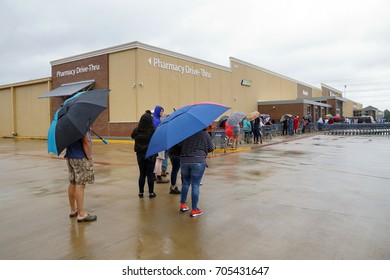HOUSTON, USA - AUGUST 29, 2017: Consequences of the  Hurricane Harvey. Desperate Texans line up in the rain as grocery stores Walmart start to reopen