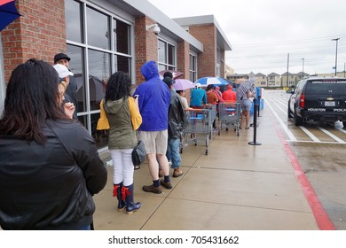 HOUSTON, USA - AUGUST 29, 2017: Consequences of the  Hurricane Harvey. Desperate Texans line up in the rain as grocery stores start to reopen