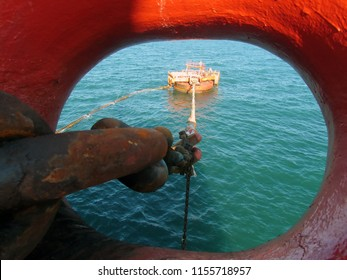 Houston, USA - February 28, 2018: Offshore oil loading from single buoy mooring into oil tanker. Single buoy mooring serves as mooring point for tankers loading and offloading gas and liquids