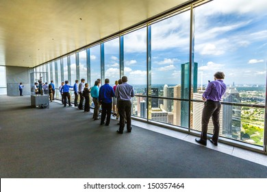HOUSTON, USA - JULY 11: people enjoy the scenic view from JPMorgan Chase tower on July 11, 2013 in Houston, USA. The visitor platform is open to public during office hours without entrance fee.