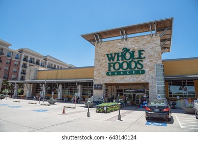 HOUSTON, US-MAY 13, 2017:Exterior facade of Whole Foods Market store. Eco-minded supermarket chain featuring foods without artificial preservatives, colors, flavors, sweeteners, and hydrogenated fats.