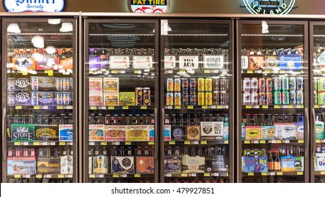 HOUSTON,US-AUG 21,2016:Various bottles of craft, microbrew, IPA, domestic and imported beers from around the world on shelf display in supermarket cooler.Alcohol drink background, different beer style