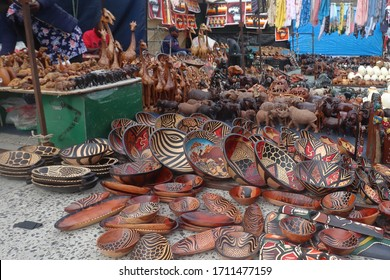 Hout Bay, South Africa _ March 11 2020 : African crafts and curios at a stall in Hout Bay Harbour near Cape Town, South Africa.