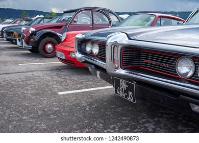 Houtaud/Franche Comté/France/June 2018 : Forthood Of A Pontiac Oldtimer And Various European Cars Park At Oldtimer car Rallye