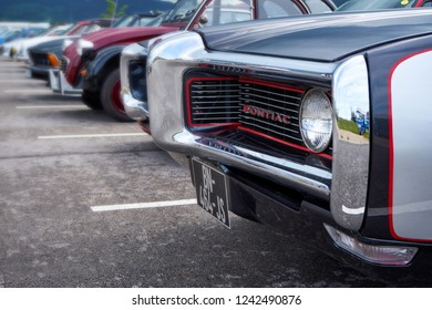 Houtaud/Franche Comté/France/June 2018 : Forthood Of A Pontiac Oldtimer And Various European Cars Park At Oldtimer car Rallye