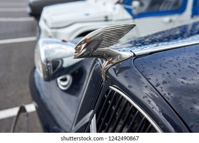 Houtaud/Franche Comté/France/June 2018 : Hood Ornament of The Mid-Size Luxury Car Citroen Traction Sits On The Front Of A Citroen car