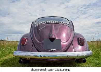 Houtaud/Franche Comté/France/June 2018 : Shiny Purple Volkswagen Beatle Parks At Oldtimer Car Rallye