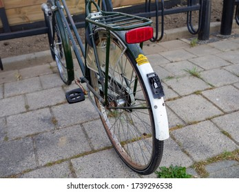 Houten, Utrecht / Netherlands - 05 24 2020: Bicycle with a broken taillight and rusted rims.