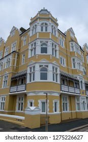 Hove, Sussex UK. December 2018. St Aubyns Mansions on Kings Esplanade. Restored mustard coloured block of flats overlooking the sea in Hove. One time home of Dame Clara Butt and Vesta Tilley.