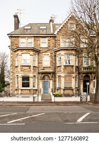 HOVE, UK - 4 DECEMBER 2018: A traditional large Victorian terrace town house built from local stone in Hove on the south east of England.