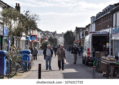 Hove, United Kingdom - March 27 2018:   Shoppers do their shopping in George St in Hove
