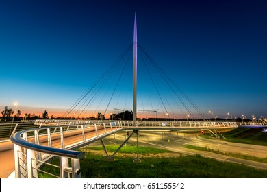 The Hovenring during sunset, a unique bridge hanging above the roads is designed to let bikers and pedestrians safely cross the busy roads.