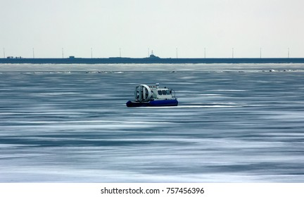 Hovercraft (aircushion vessel) among spring unreliable ice. All-terrain vehicle, melting ice