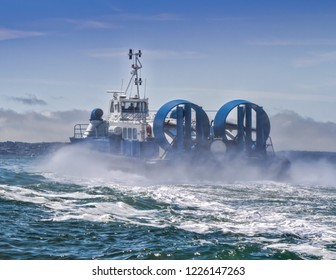 Hovercraft in motion over sea