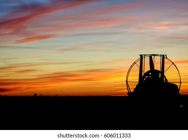 Hovercraft on the background of the orange sky
