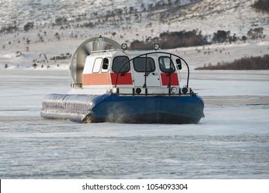 A hovercraft on ice of Baikal lake