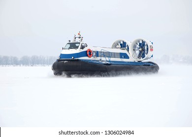 Hovercraft rushes on a snow-covered river