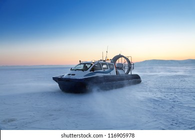 Hovercraft transport on the frozen lake Baikal at the time of sunset, Siberia, Russia