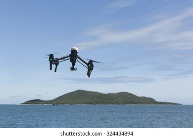 hovering drone with camera in clear blue sky