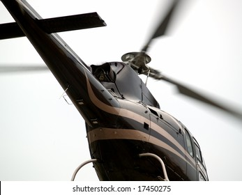 Hovering helicopter's tail closeup low angle view