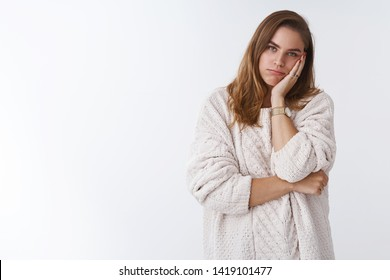 How boring. Portrait of sleepy tired annoyed woman listening boring uninteresting lecture forced hear parents scolding facepalming leaning face bored, standing indifferent careless white background