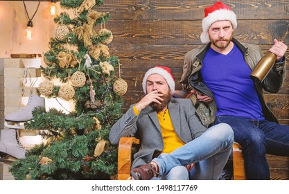 How to break bad habits. Men drink champagne and smoking. Brutal men celebrate new year near christmas tree. New years resolution. Bad habits to kick before the end of year. Get rid of harmful habits.