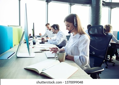 How can I help you? Female customer support operator with headset and smiling