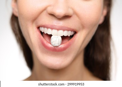 How to care for a beautiful smile?  A woman with cracked lips coral in the teeth symbolizes the problems with the enamel