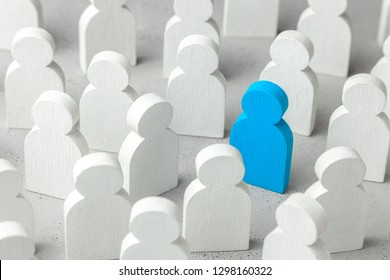 How to choose a leader from the crowd of staff. Lot of people and one special employee. Staff recruitment.