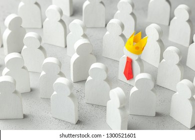 How to choose a leader from the crowd of staff. Lot of people and one special employee in red tie and crown. Staff recruitment.