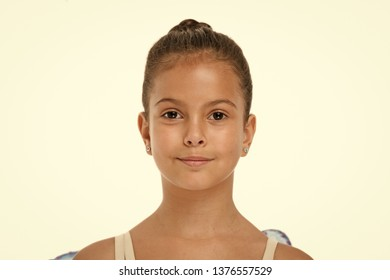 How to do ballet bun. Proper hairstyle for pupil ballerina. Make proper hairstyle visit ballet classes. Girl cute smiling face with neat and tidy bun hair. Perfect appearance excellent student.