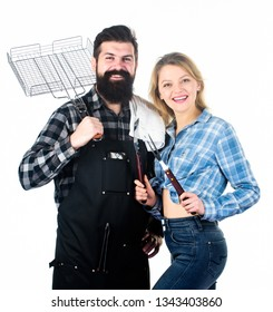 How do you like your steak burnt. Couple of man and woman holding barbeque set. Barbeque is a cooking method. Happy couple having barbeque party. Cooking with barbeque grill.