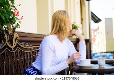 How enjoy being single tips. Woman lonely wait date. Dating advice for women. Still waiting him. Woman sits alone cafe terrace urban background defocused. Girl sit alone cafe waiting him.