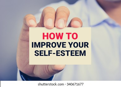 HOW TO IMPROVE YOUR SELF-ESTEEM, message on the card shown by a man, vintage tone