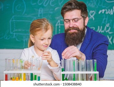 How to interest children study. Fascinating chemistry lesson. Man bearded teacher and pupil with test tubes in classroom. Private lesson. School chemistry experiment. Explaining chemistry to kid.