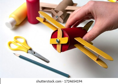 How to make airplane. Hand made toy,zero waste from toilet paper roll and popsicle sticks. Modeling. Step 21 put all details of aircraft together. DIY for child, ideas to make during home quarantine.