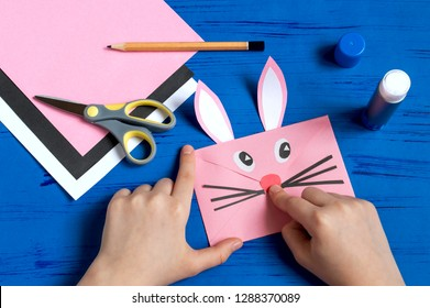 How to make envelope in form of bunny for Easter greetings. Children's art project. DIY concept. Step by step photo instruction. Step 11. Glue bunny nose