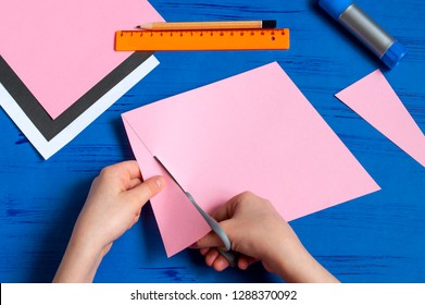 How to make envelope in form of bunny for Easter greetings. Children's art project. DIY concept. Step by step photo instruction. Step 3. Cut rhombus
