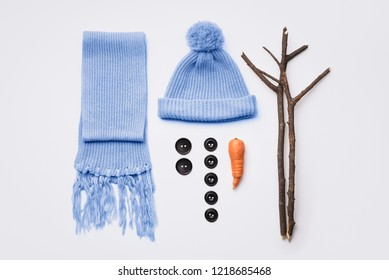 How to make a snowman. Hat, scarf, carrot, buttons and tree branches - set for winter fun