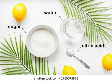 How to make sugar paste for home hair removal. An alternative to a beauty salon during the pandemic. Ingredients for home sugaring: sugar, water, citric acid. Flat lay on a white table.